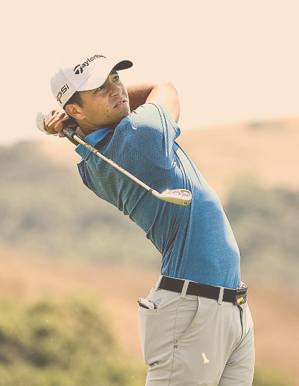 Xander Schauffele Swinging a Golf Club